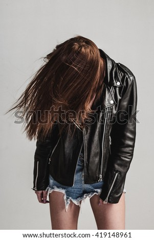 young pretty sexy woman in leather jacket - stock photo