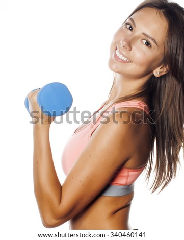 young pretty slim woman with dumbbell isolated cheerful smiling - stock photo