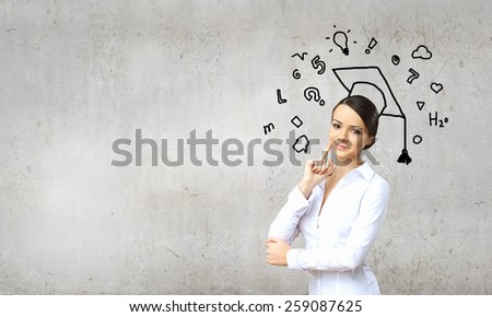 Young pretty smiling woman wearing drawn bachelor hat - stock photo