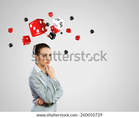 Young pretty thoughtful woman trying to make decision - stock photo