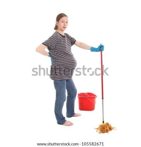 young pretty tired pregnant woman cleaning the house - stock photo