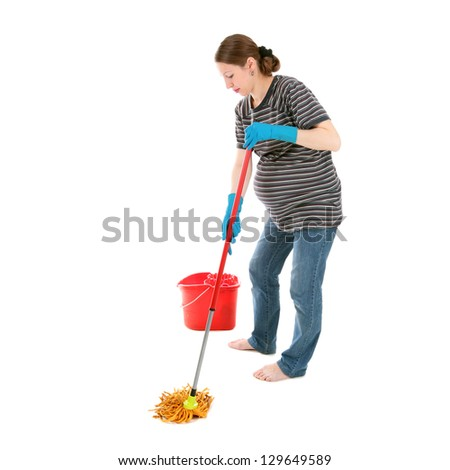 young pretty tired pregnant woman cleaning the house