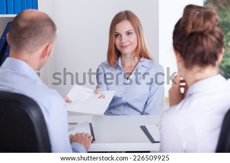 Young pretty woman and the beginning of her job interview - stock photo