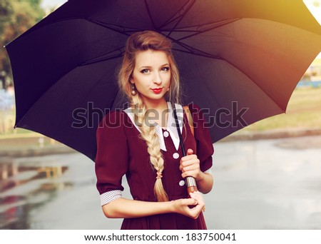 Young pretty woman closeup portrait with umbrella in summer. Beautiful blonde hipster girl outdoor in city vintage style - stock photo