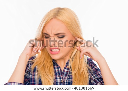 Young pretty woman covering her ears ignoring noise - stock photo