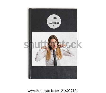 Young pretty woman covering her ears printed on book - stock photo