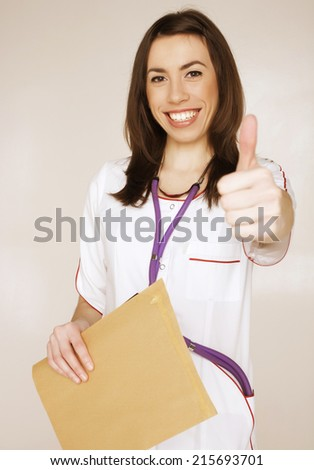 young pretty woman doctor with stethoscope close up - stock photo