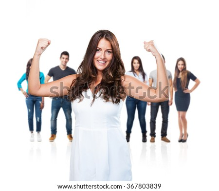 young pretty woman doing a strong gesture - stock photo
