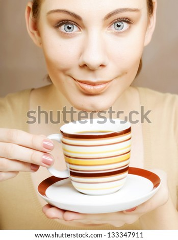 young pretty woman drinking coffee - stock photo