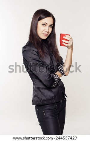 Young pretty woman drinking tea or coffee