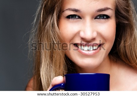 young pretty woman drinks coffee - stock photo