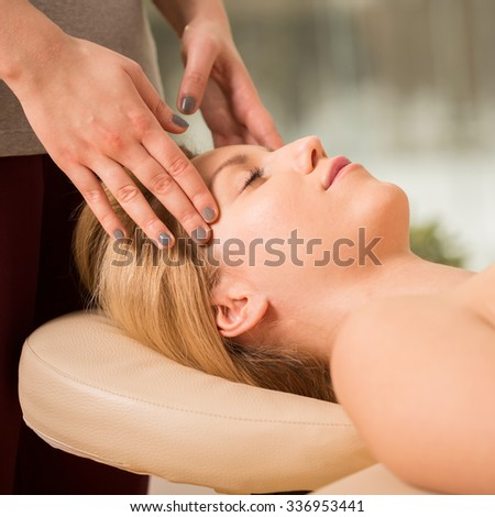 Young pretty woman during her head massage