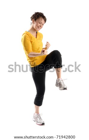 Young pretty woman exercises isolated on white background. - stock photo