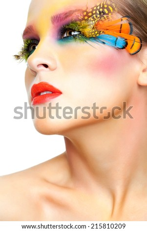 Young pretty woman face with false feather eyelashes fashion makeup - stock photo