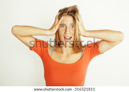 young pretty woman hands on head, screaming isolated white close up - stock photo