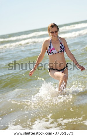 young pretty woman having fun at the sea