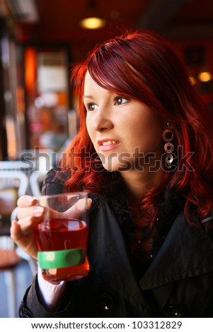 young pretty woman holding a cup of tea