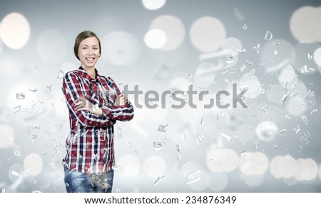 Young pretty woman in casual against bokeh background - stock photo