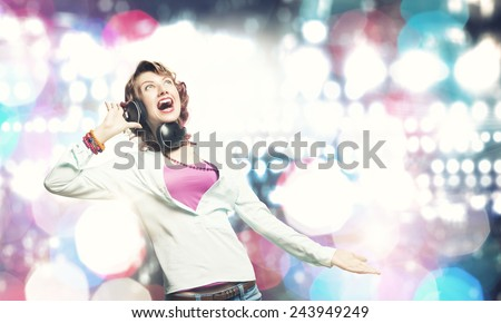 Young pretty woman in casual wearing headphones - stock photo
