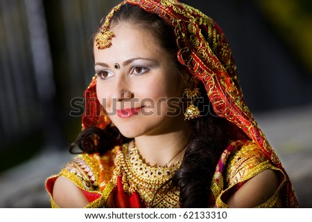 young pretty woman in indian dress look forward