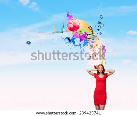 Young pretty woman in red dress covering ears with hands