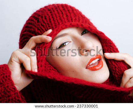 young pretty woman in sweater and scarf all over her face close up - stock photo