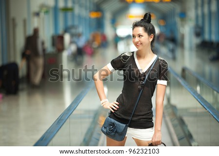 Young pretty woman in the airport - stock photo