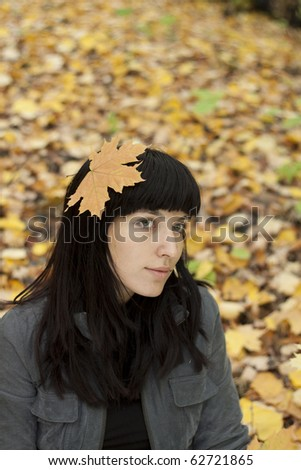 Young pretty woman in the autumn park. - stock photo