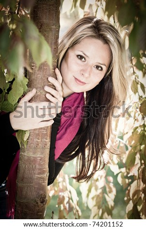 Young pretty woman in the autumn park - stock photo