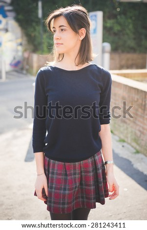 young pretty woman in town  - stock photo