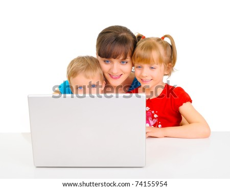 Young pretty woman is playing with her children - stock photo