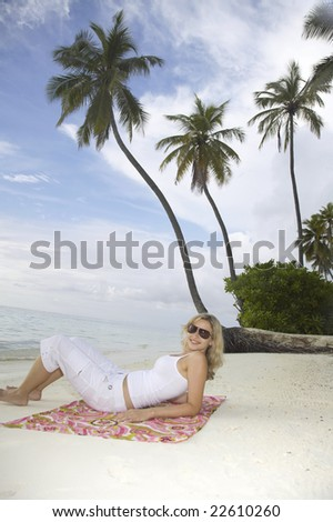 young pretty woman is posing on beach, on meeru island