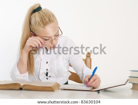 Young pretty woman learning at table.Back to school concept. - stock photo