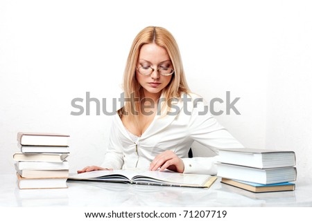 Young pretty woman learning at table with books