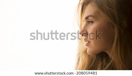 Young pretty woman looking on white background