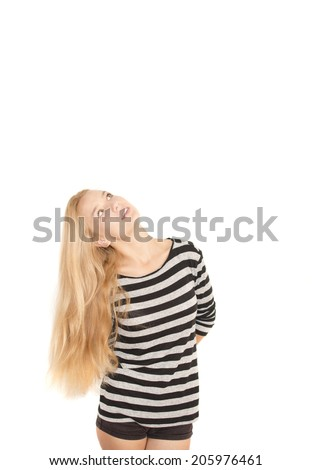 Young pretty woman looking up on white background - stock photo