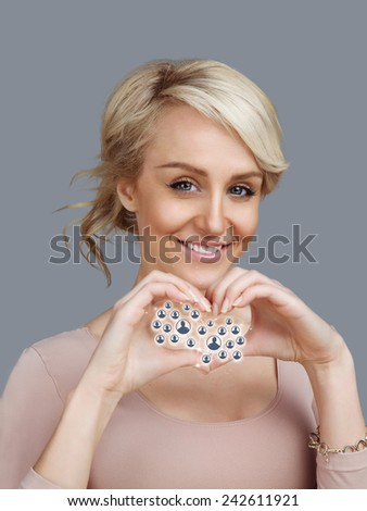 Young pretty woman make heart withl social network icons  - stock photo