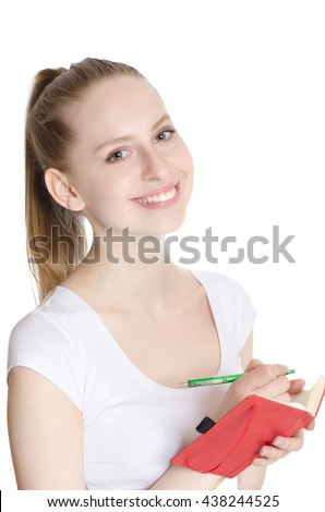 Young pretty woman making notes over white background