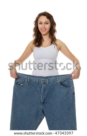 Young Pretty Woman on Diet Showing Weight Loss - stock photo