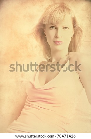 Young pretty woman on the old paper - stock photo