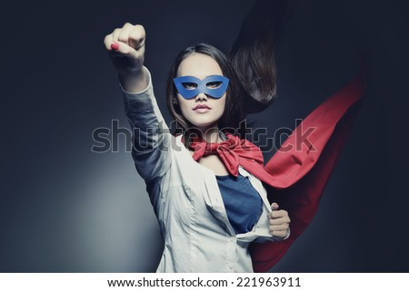Young pretty woman opening her shirt like a superhero. Super girl, image toned. Beauty saves the world. Image toned.