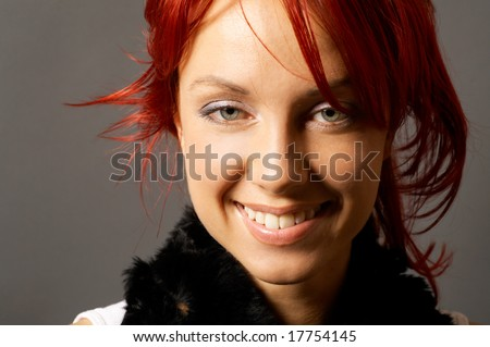 young pretty woman over grey background