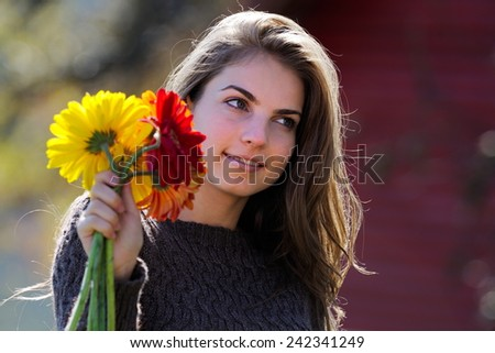 young pretty woman portrait outdoor in autumn - stock photo