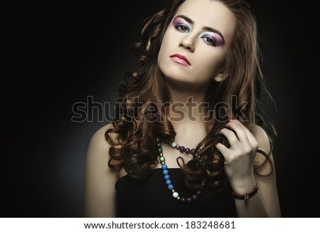 Young pretty woman posing in studio