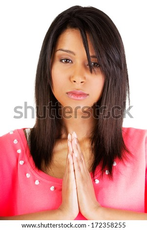 Young pretty woman praying, over white background. - stock photo