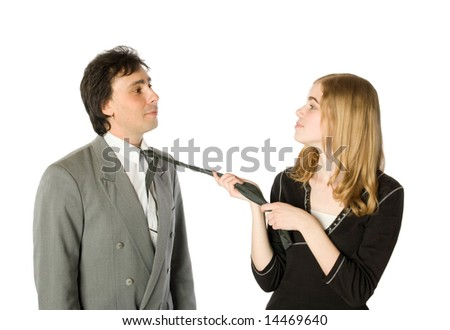 Young pretty woman pulling a man by a necktie - stock photo