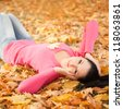 Young pretty woman relax in the autumn park - stock photo