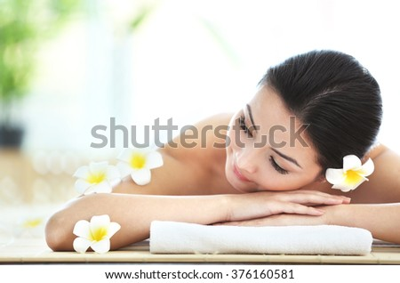 Young pretty woman relaxing in salon, close up