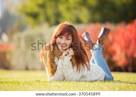 Young pretty woman relaxing in the park - stock photo