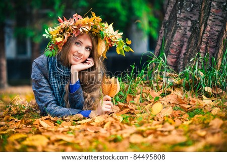 Young pretty woman rest in the autumn park - stock photo